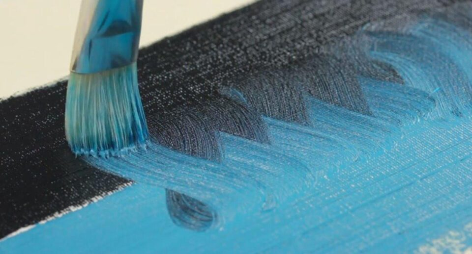 Paint brush creating a gradient with oil paint