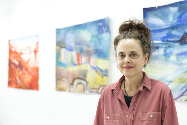 Artist Kyle Gallup in her studio