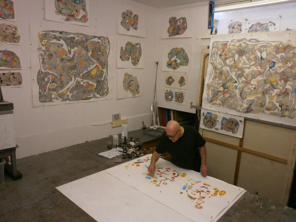 David working in his studio on large watercolours.